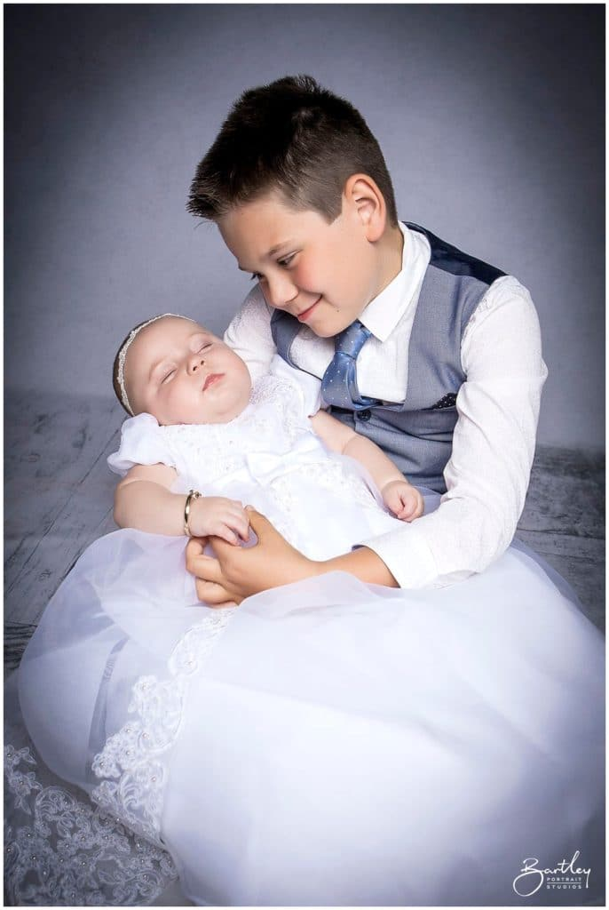 christening outfit baby portrait with brother