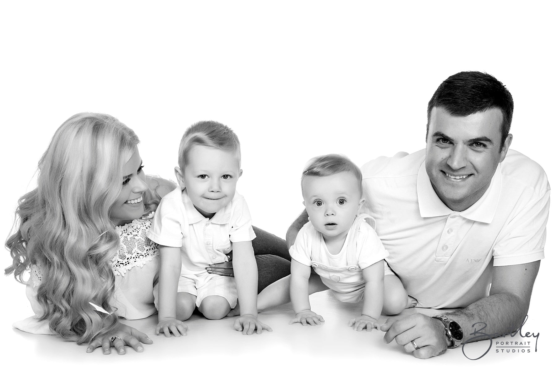 white tops family photograph takin in studio
