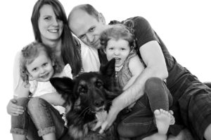 German Shepherd with family portrait