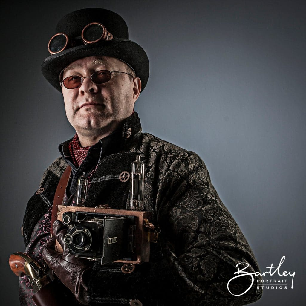 top hat and goggles with gun steam punk