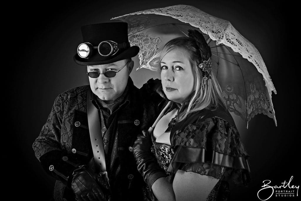 couple with goggles and unbrella steam punk style