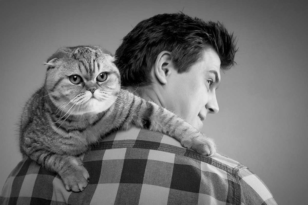 man and cat grumpy black and white photo shoot professional