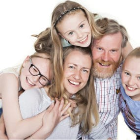 happy family portrait close together smiles taken at Bartley Studios