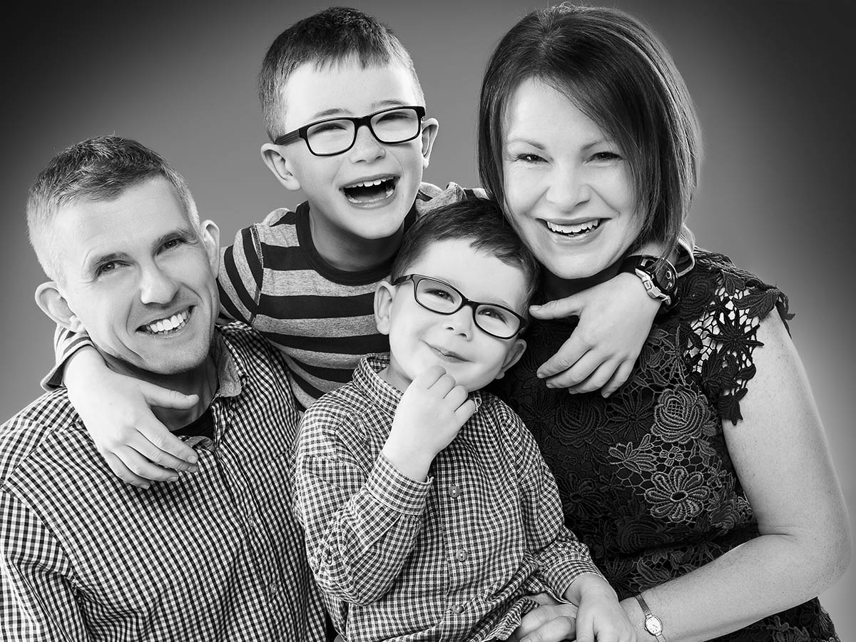 photograph mum dad and their two boys in black and white. Taken at Bartley Studios Manchester Warrington