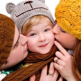 winter studio shoot parents kissing child manchester studio portrait