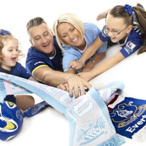everton and manchester city family portrait fighting over scarfs