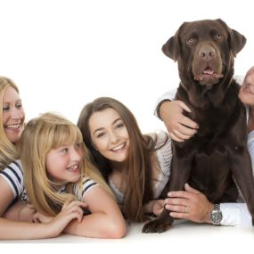 family portrait studio photograph with dog and two kids