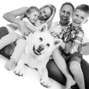 happy family portrait with their dog