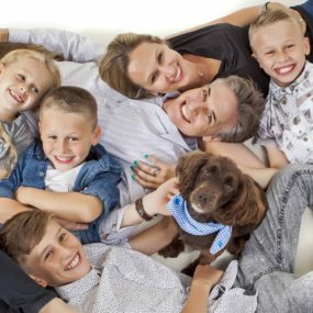 family with 4 kids and dog picture taken from above
